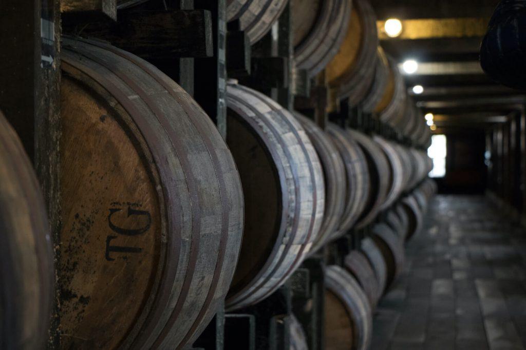 A bpourbon barrel in a rickhouse