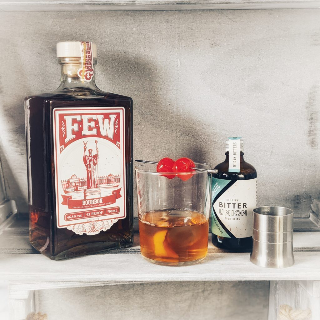 An Old Fashioned Cocktail and its components, made with FEW Bourbon
